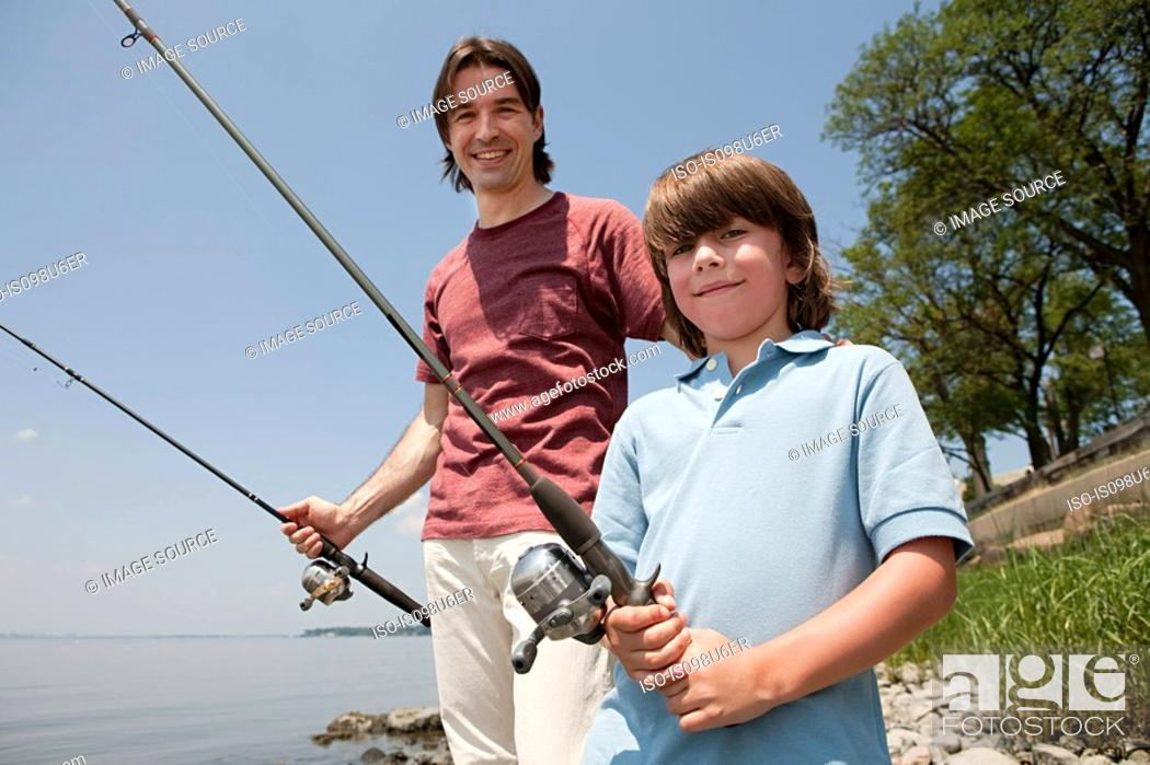 Stock Photo: Father and son on beach with fishing rods.