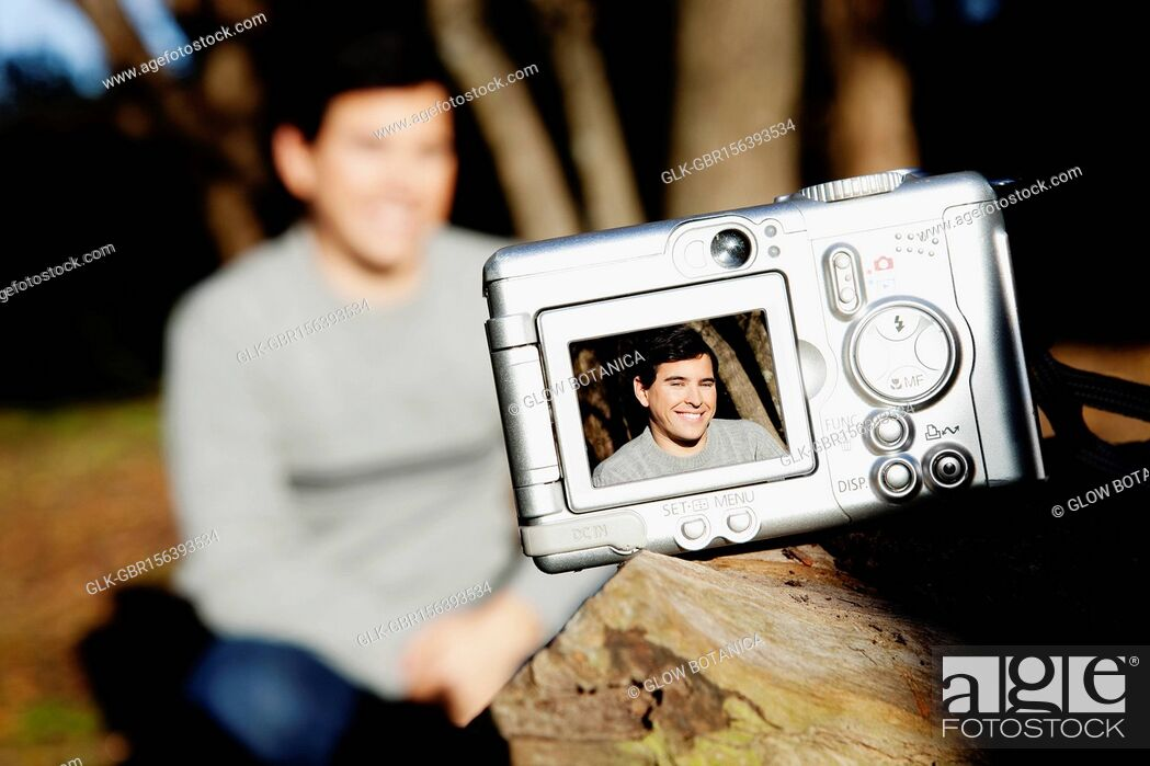 Stock Photo: Picture of a man in digital camera.
