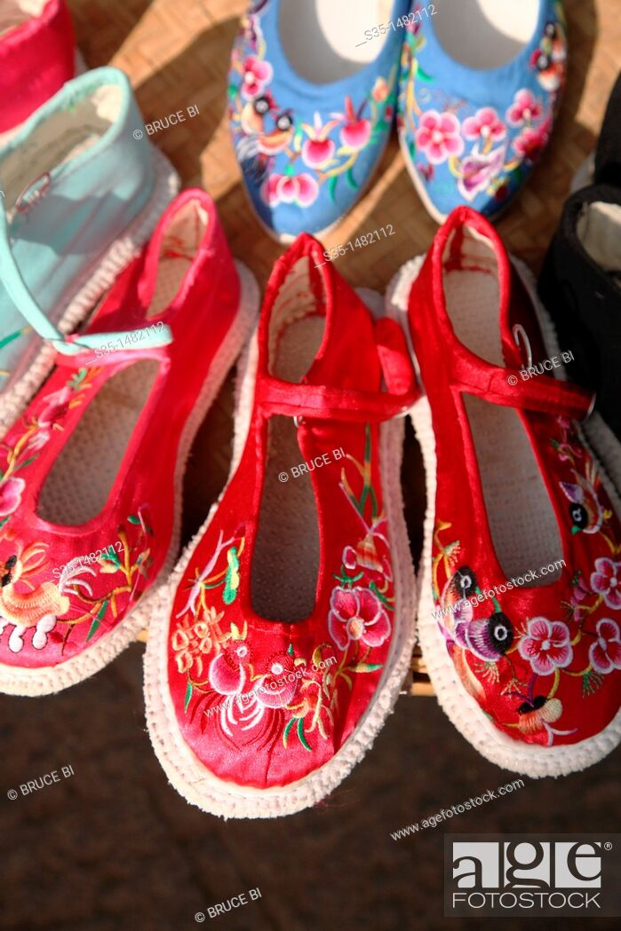 Stock Photo: Traditional style hand made embroidered shoes for sale on old town street  Town of Guandu  Kunming  China.