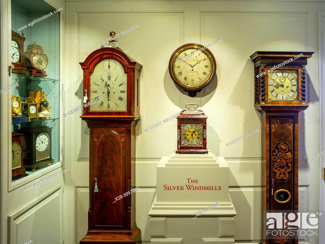 Stock Photo: Longcase and other antique clocks on display at the premises of Carter Marsh and Co. in Winchester, England (Permission to photograph kindly given by Andrew.