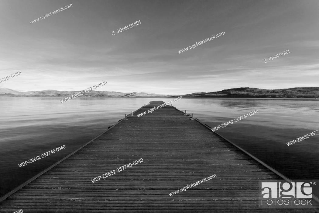 Stock Photo: Wooden jetty reaching towards the horizon, Loch Lomond, Scotland, UK.