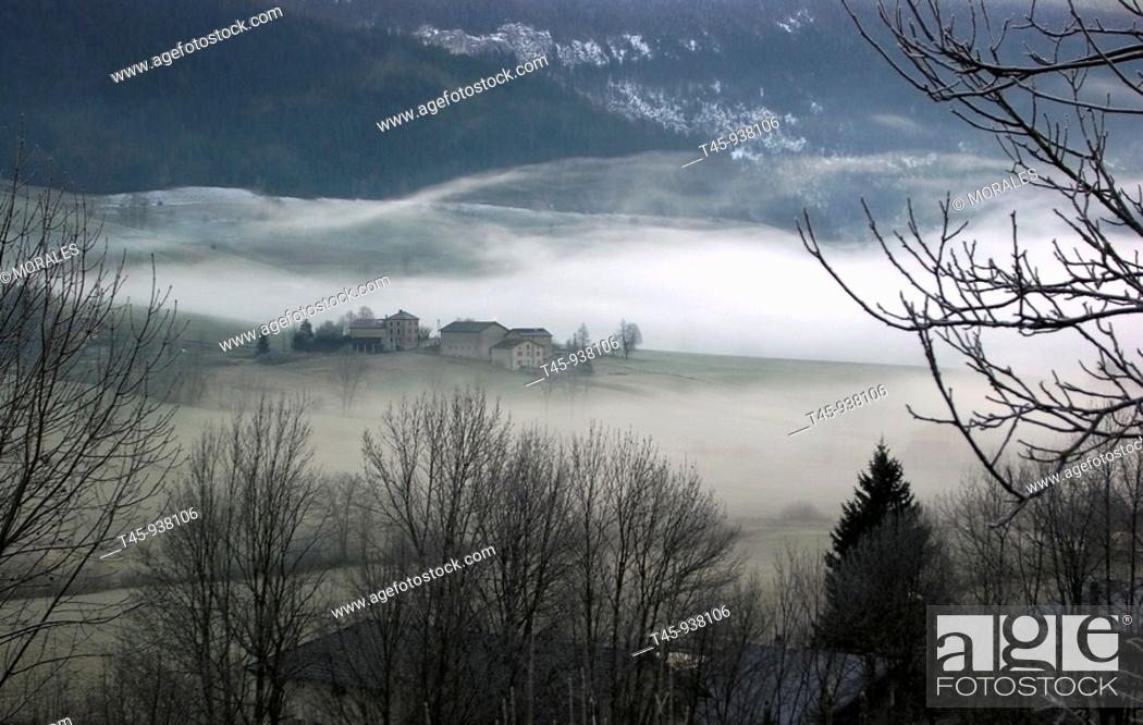 Stock Photo: Les Abissaux hamlet in fog at sunrise in winter, Vercors, Drôme, France.