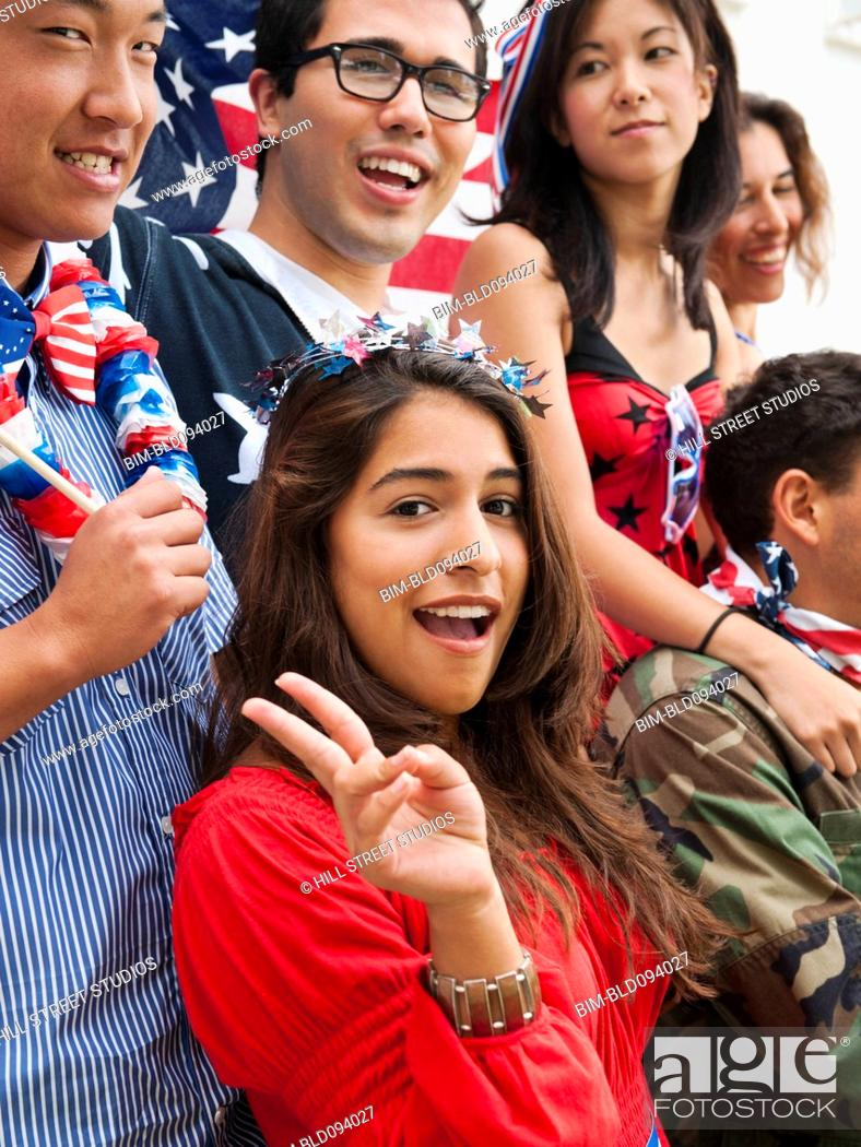 Stock Photo: Friends holding American flags on Fourth of July.