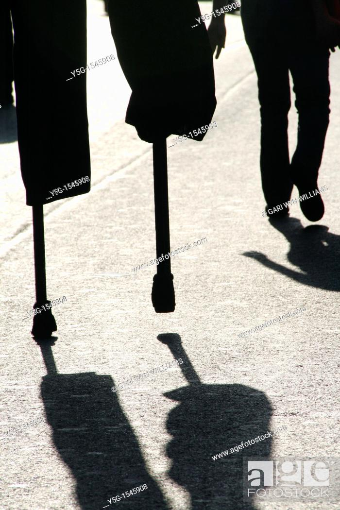 Stock Photo: person man walking on stilts in street road in city town.