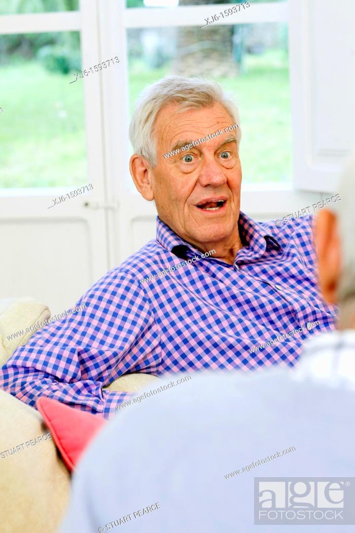Stock Photo: Senior men, chatting.