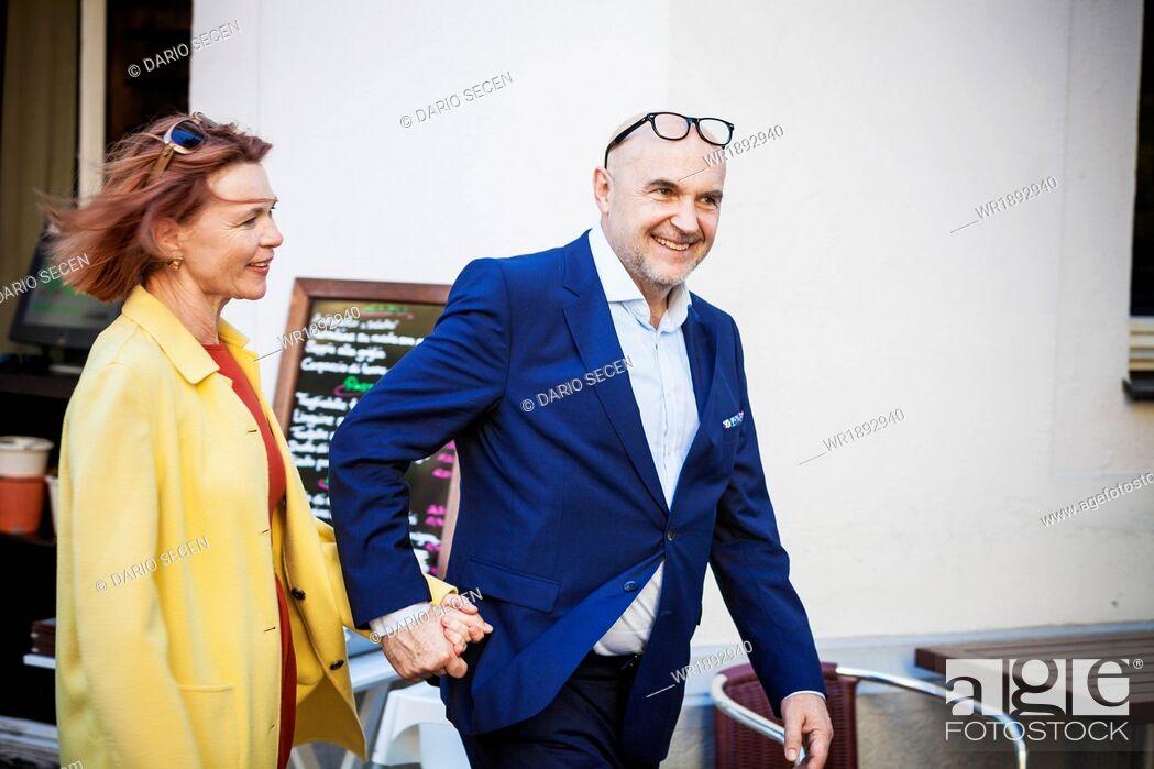 Stock Photo: Senior couple holding hands, Munich, Bavaria, Germany.