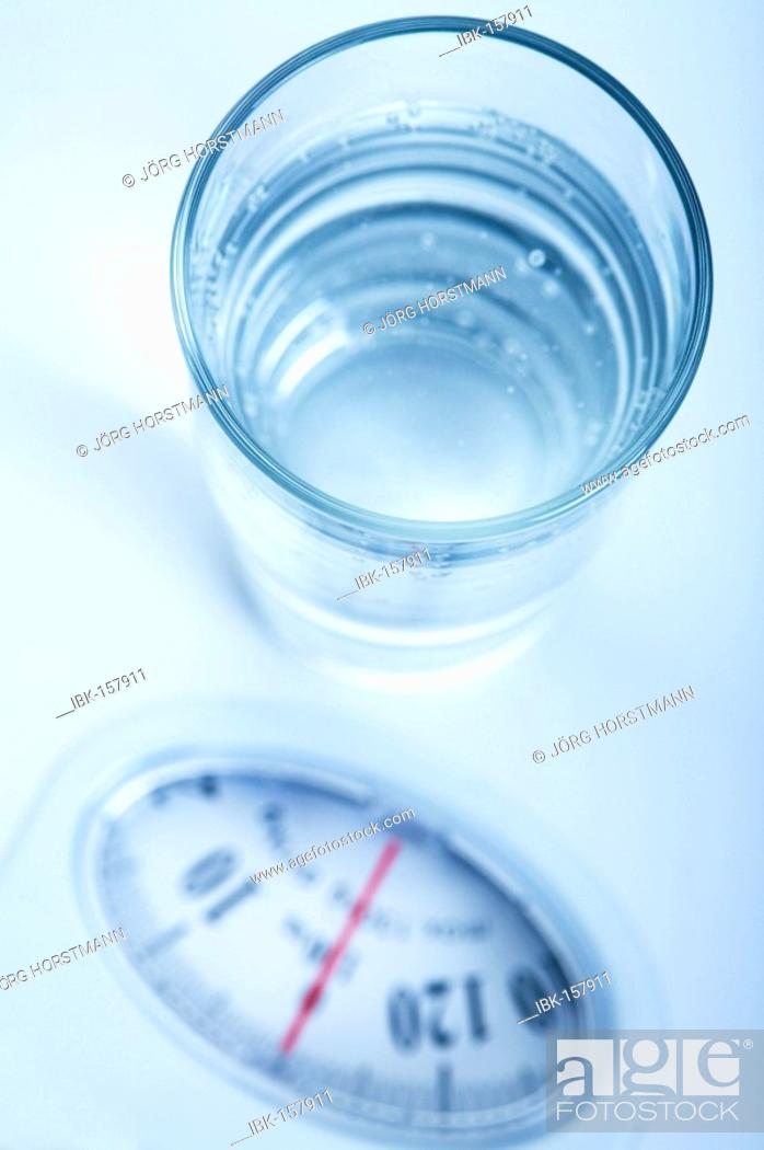 Stock Photo: Water glass on a balance.