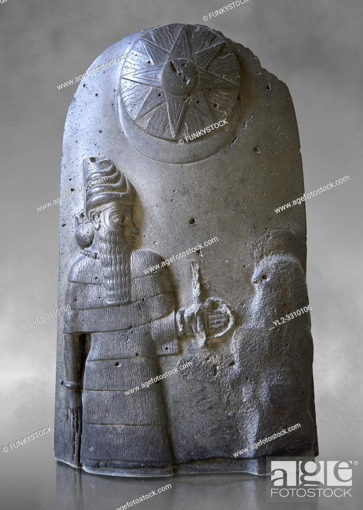 Stock Photo: Basalt Babylonian sculpture reporting the spoils of war, 12th cent. BC. The Louvre Museum, Paris.