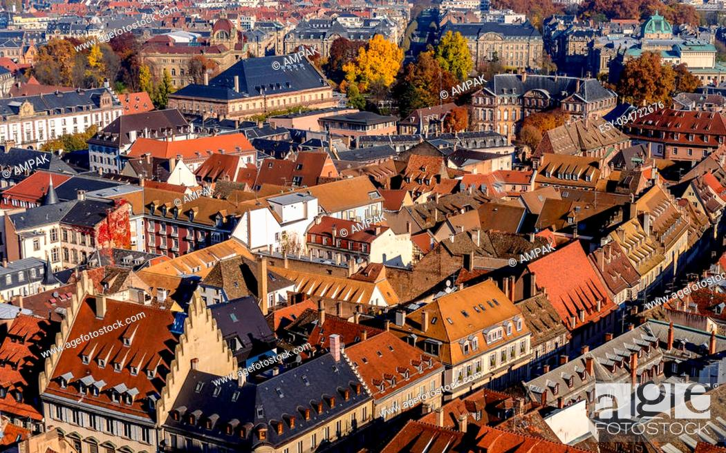 Stock Photo: Vivid medieval house roofs covered with traditional red and orange tiles in Strasbourg city.