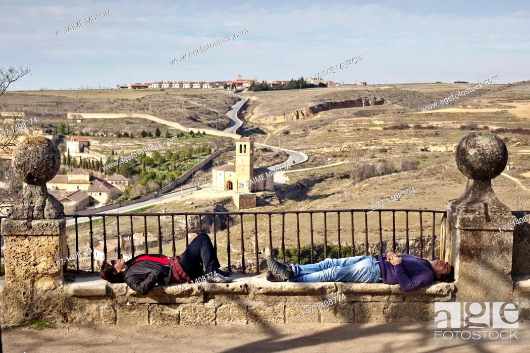 Stock Photo: People sleeping near the Alcázar of Segovia.