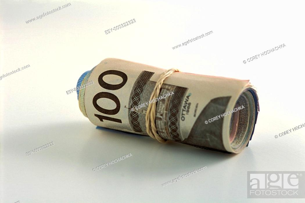 Photo de stock: Roll of money with a hundred on outside.
