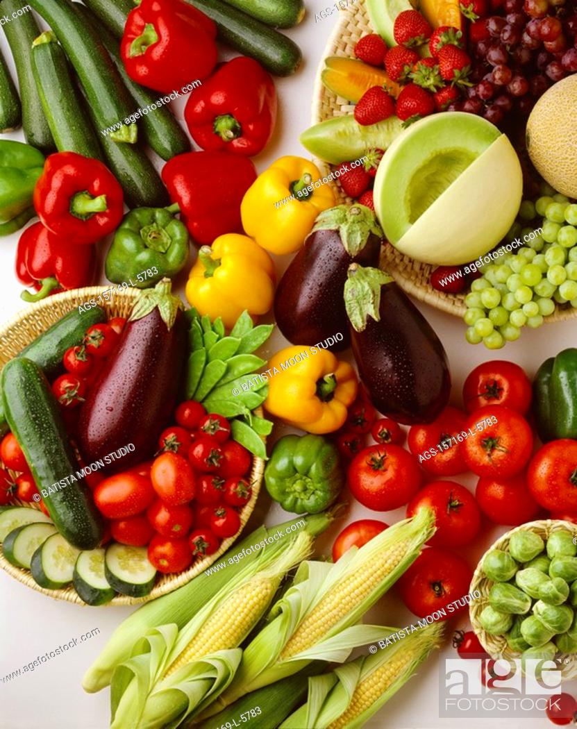 Stock Photo: Agriculture - Arrangement of fruits and vegetables on white: strawberries, red & green grapes, honeydew melon, cantaloupe, tomatoes, eggplant, brussels sprouts.