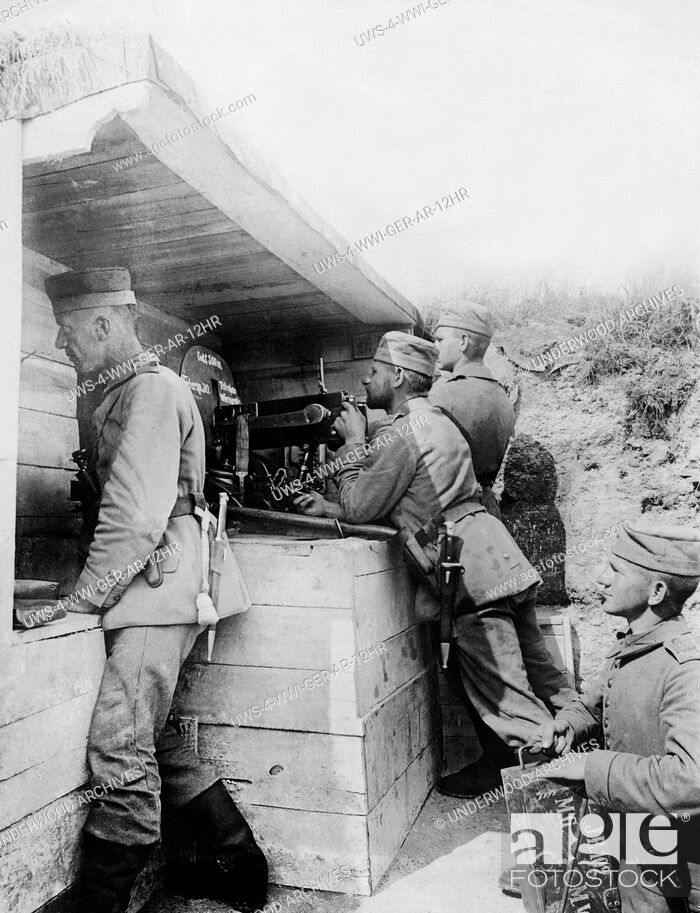 Stock Photo: Europe: July 15, 1916 A German machine gun crew firing upon the enemy 200 meters away.The crew is under a bomb proof shelter and is firing 600 bullets a minute.