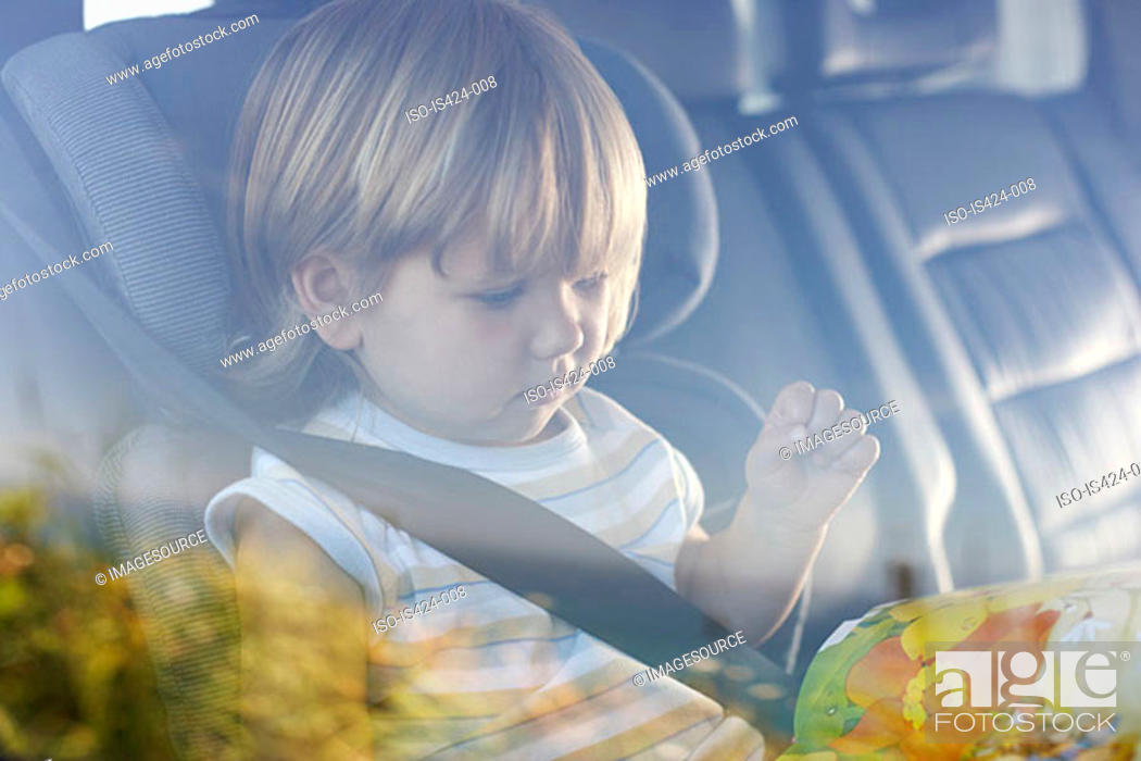 Stock Photo: Child sitting in car.