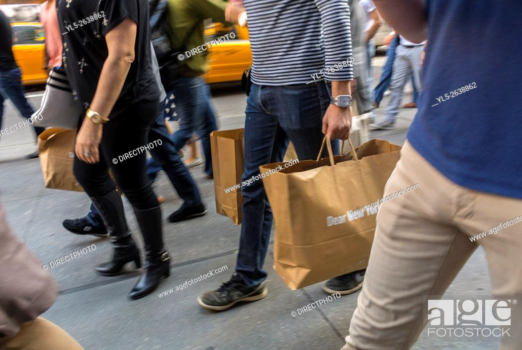 Imagen: New York City, USA, Street Scenes Shopping on Fifth Avenue, Detail, Group Men Carrying Shopping Bags,.