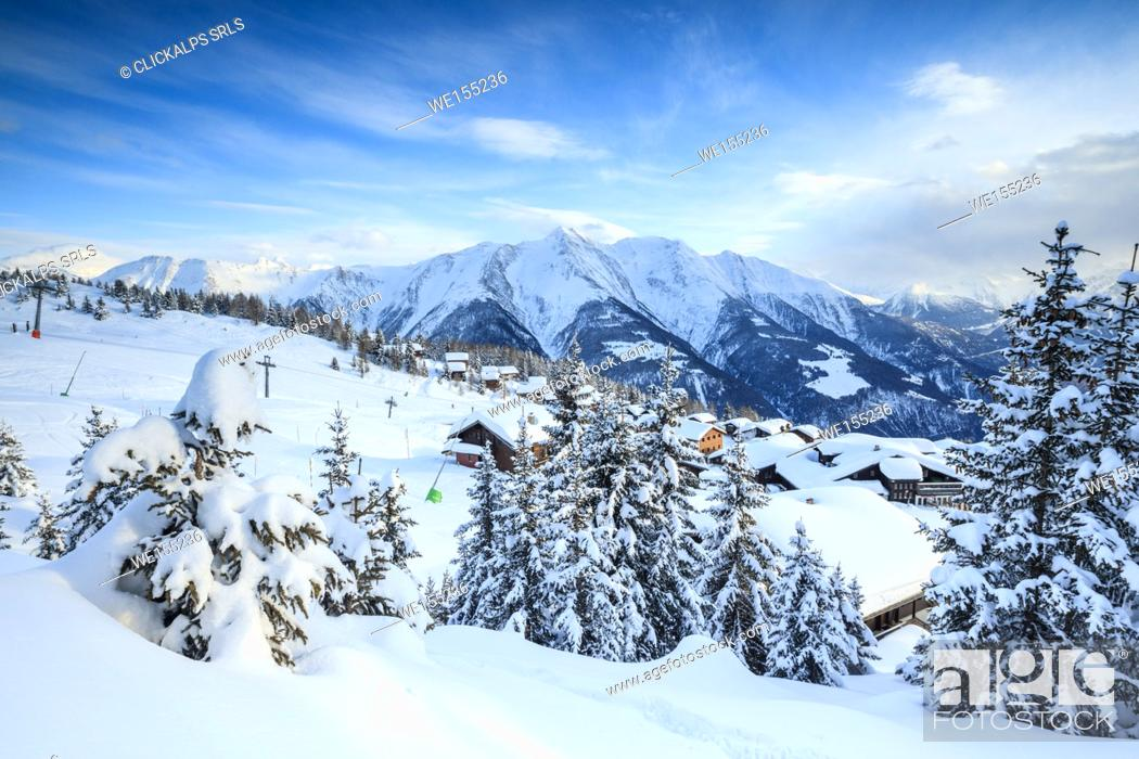 Stock Photo: Snowy woods and mountain huts framed by the winter sunset Bettmeralp district of Raron canton of Valais Switzerland Europe.