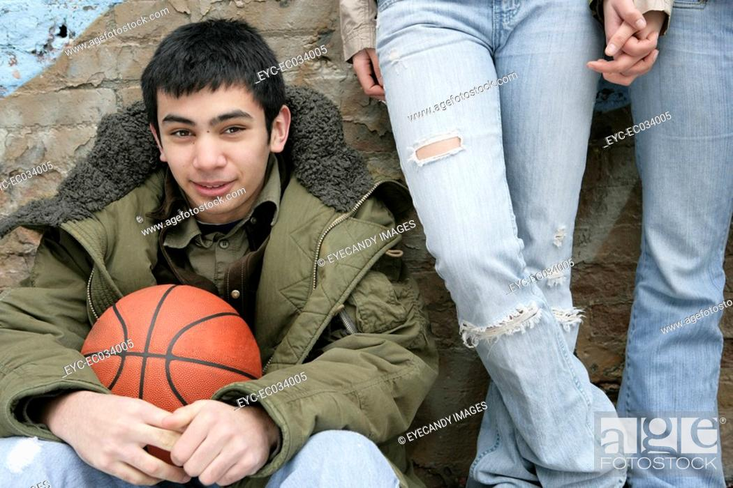 Stock Photo: View of a young man with a basketball.