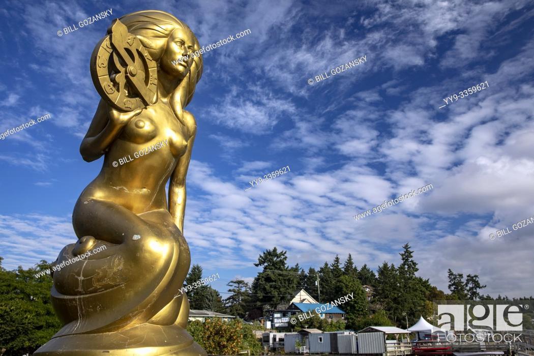 "Stock Photo: Ganges Harbour Mermaid - Bronze mermaid statue named """"Nerissa"""" by artist: Thomas Richard McPhee - Salt Spring Island, British Columbia, Canada."