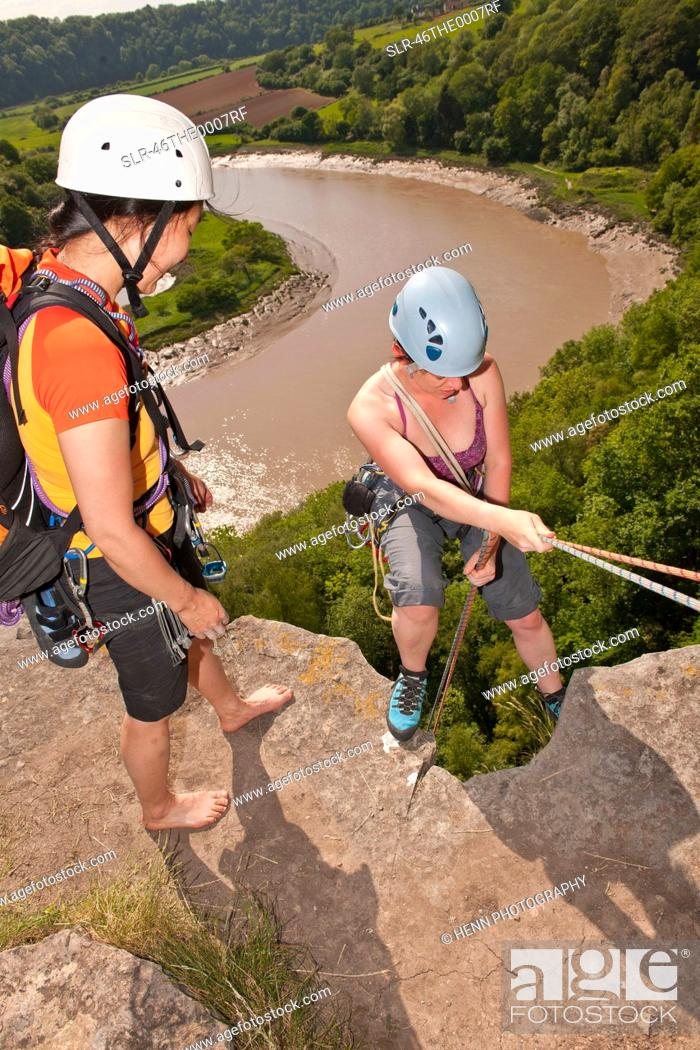 Stock Photo: Climbers standing on mountaintop.