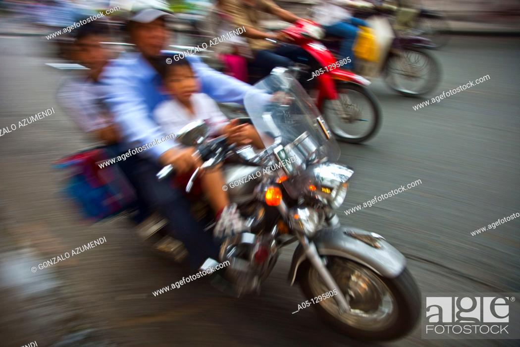 Stock Photo: People in motorbike. Ho Chi Minh City (formerly Saigon). South Vietnam.