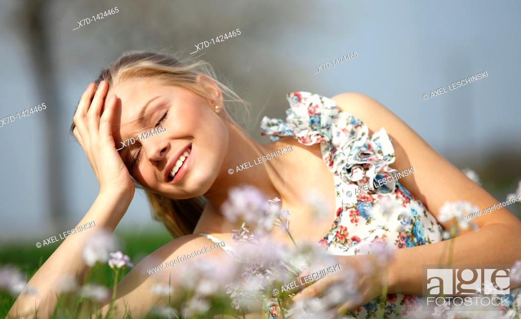 Stock Photo: woman lying in grass.