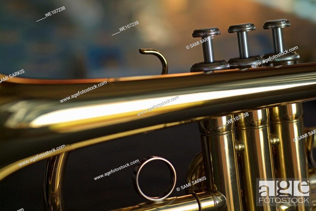 Stock Photo: Three musical keys on a shiny trumpet.