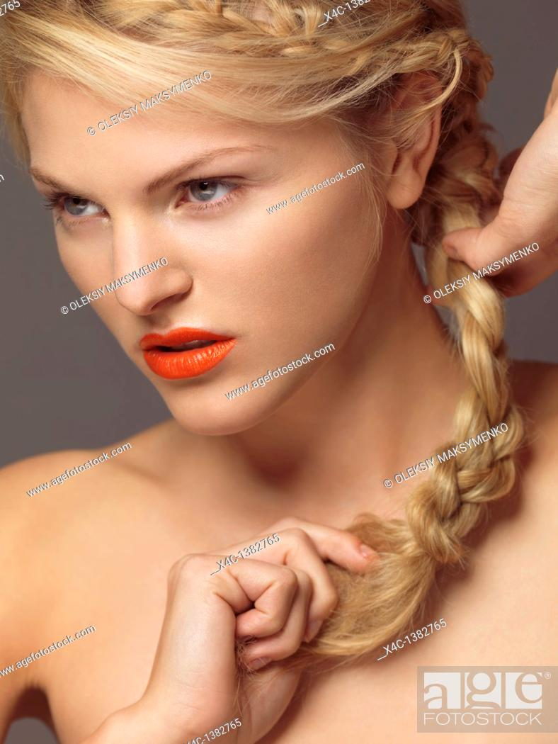 Stock Photo: Beauty portrait of a young woman with bright orange lipstick.