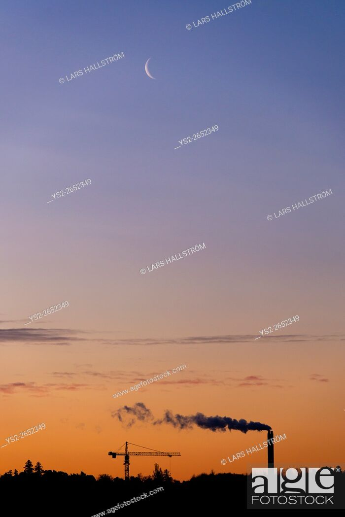 Stock Photo: Industry silhouette, smokestack and construction crane with copy space on night sky. Concept of urban development and environment.