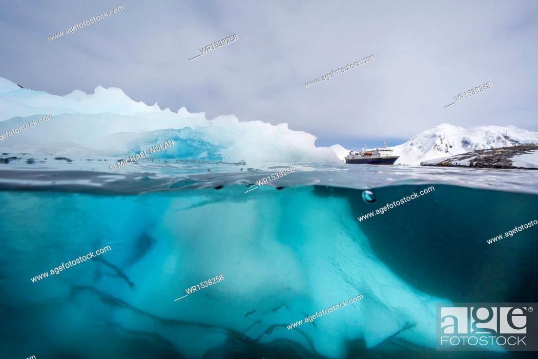 Stock Photo: Above and below view of glacial ice near Wiencke Island, Neumayer Channel, Antarctica, Polar Regions.
