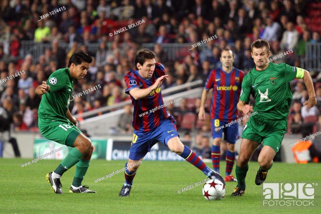 Stock Photo: Barcelona, Camp Nou Stadium, 20/10/2009, UEFA Champions League, FC Barcelona vs. FC Rubin Kazan, Messi dribbling through Russian defenders.