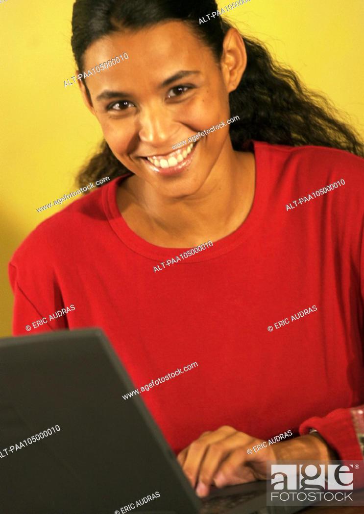 Stock Photo: Woman using laptop computer, portrait.