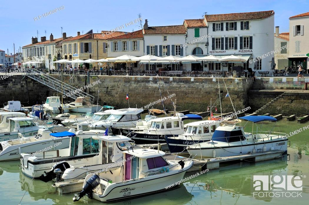 Pleasure Boats And Restaurants In The Harbour At Saint Martin De Re