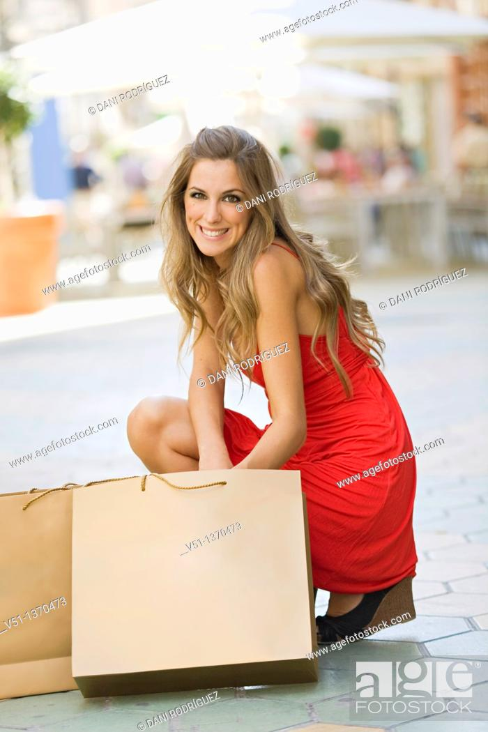Stock Photo: Portrait of a beautiful blonde woman shopping.