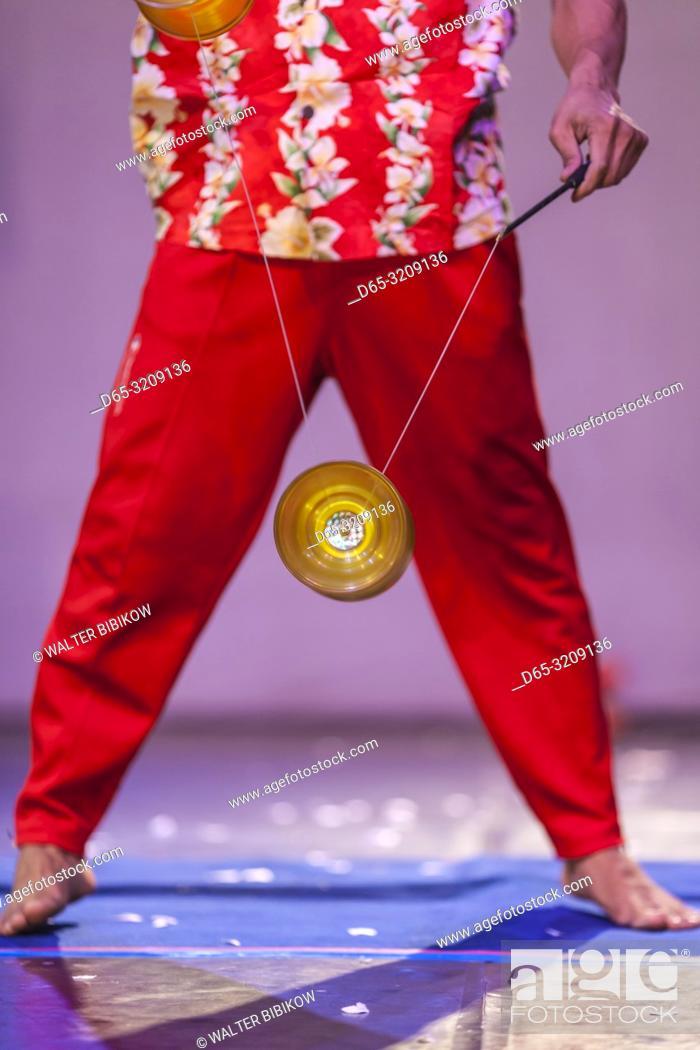 Stock Photo: Cambodia, Battambang, Phar Ponleu Selpak, arts and circus school, juggler with top during circus performance, ER.