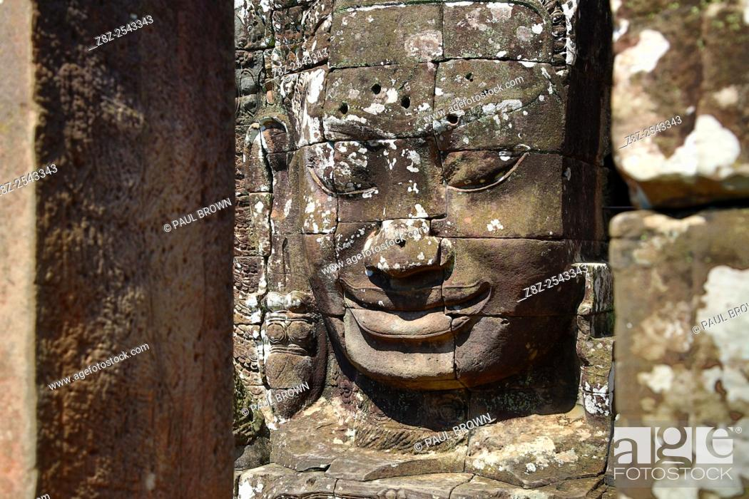 Stock Photo: Giant face statue at Bayon, Khmer Temple in Angkor Thom, Siem Reap, Cambodia. Built in the late 12th / early 13th century as the official state temple of the.