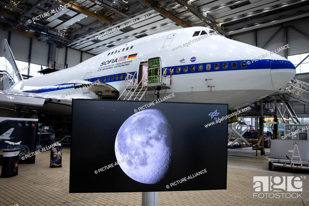 Stock Photo: 26 October 2020, Hamburg: At a press conference, a monitor showing a picture of the moon stands in front of the converted Boeing 747 with the Stratospheric.