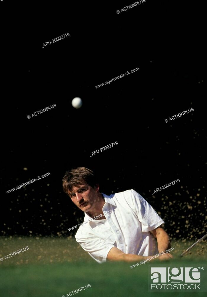 Stock Photo: Golfer chips the ball out of the bunker.