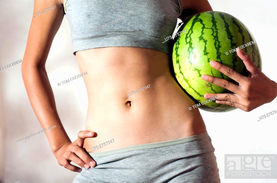 Stock Photo: Slim woman with melon.