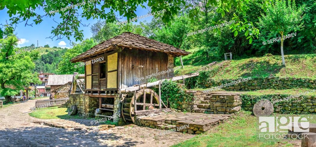 Stock Photo: Water mill in the Etar Architectural Ethnographic Complex in Bulgaria on a sunny summer day. Big size panoramic photo.