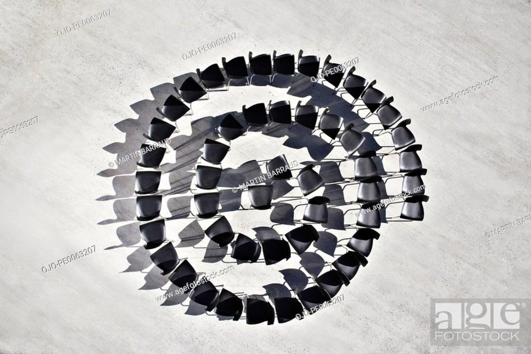 Stock Photo: Office chairs in spiral formation.