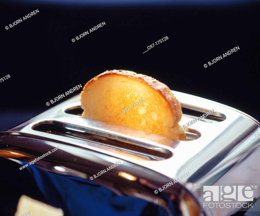 Stock Photo: Slice of bread in toaster.