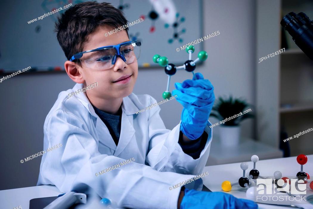 Stock Photo: Schoolboy holding molecular model.