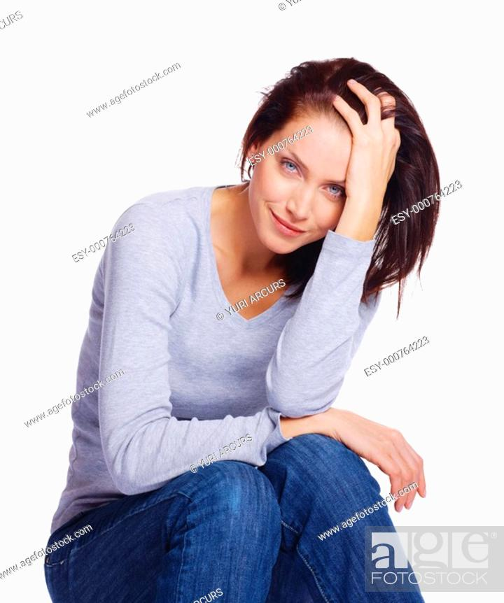 Stock Photo: Portrait of a beautiful young woman sitting over white background.