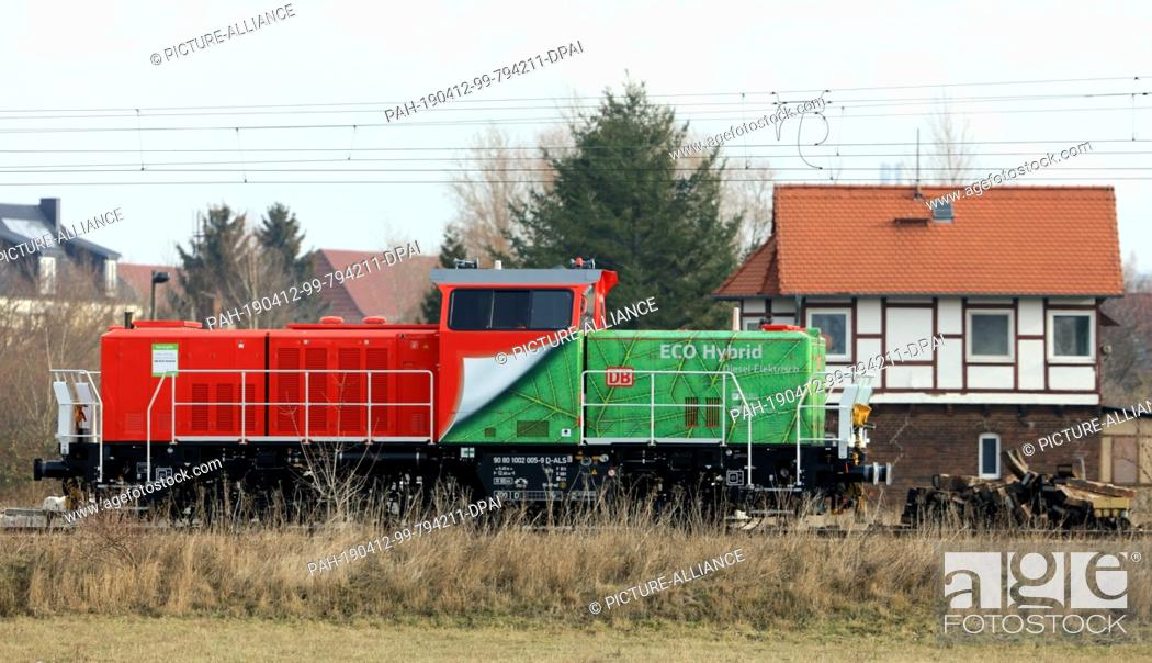 Stock Photo: 06 February 2019, Saxony-Anhalt, Magdeburg: A hybrid locomotive H3 from Alstom travels through the Rothensee marshalling yard.