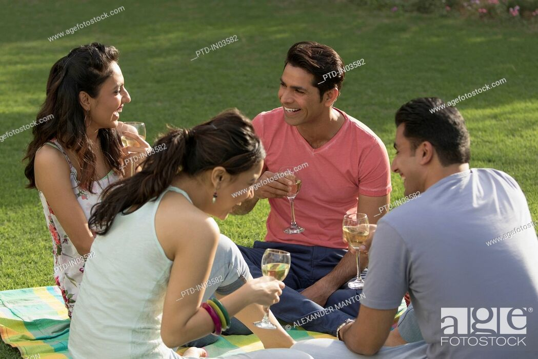 Stock Photo: Friends at picnic laughing.