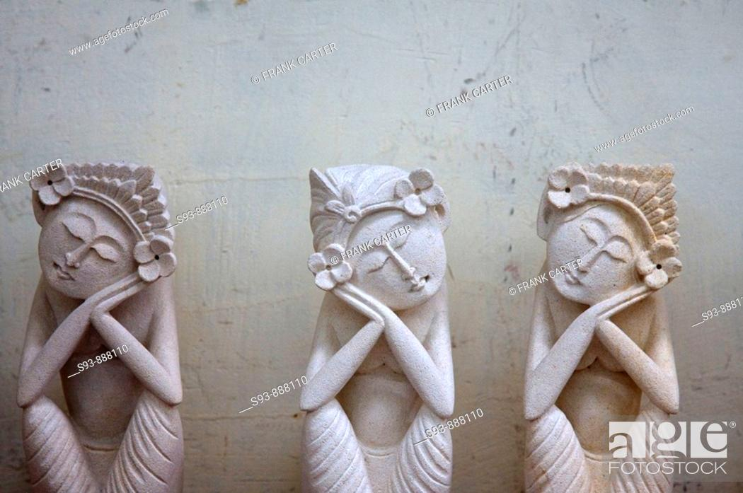Stock Photo: Three white stone figures of women that seem to be sleeping in sitting positions in Ubud, Bali.