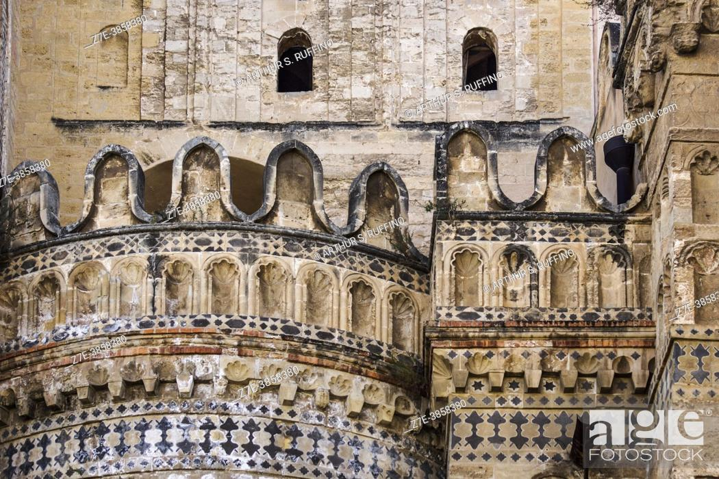 Stock Photo: Detail of the intricate decorative lava stone inlay work on the east side exterior of the Palermo Cathedral. Side apse. Palermo, Sicily, Italy.