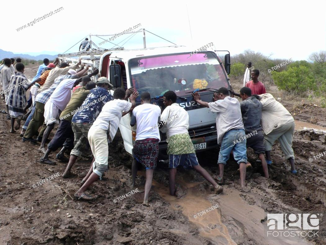 Stock Photo: The roads are bad in Ethiopia and all the cars get stuck in the mud.