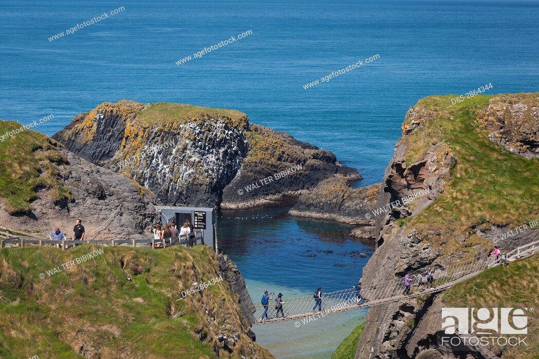 Stock Photo: UK, Northern Ireland, County Antrim, Ballintoy, pathway to the Carrick-a-Rede Rope Bridge.