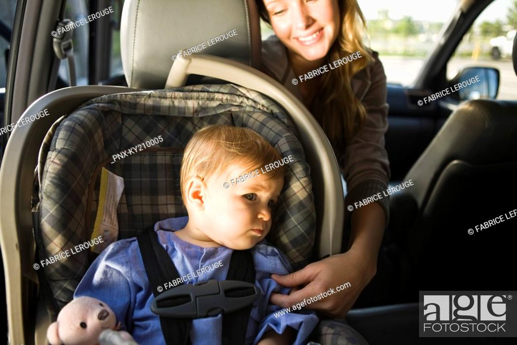 Stock Photo: Woman with her son in a car.